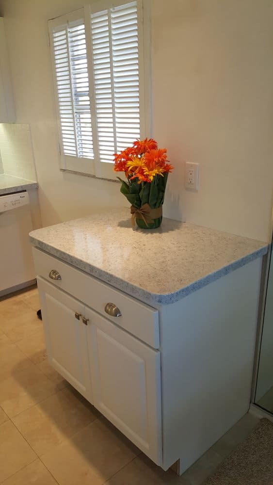 Custom additional cabinetry and resurfaced countertop