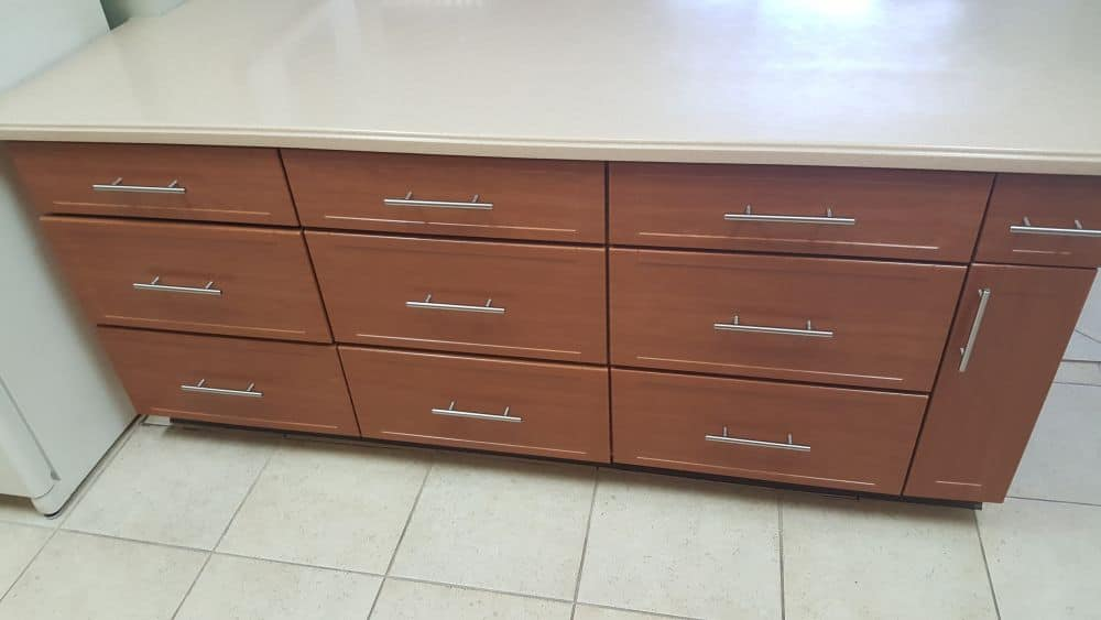Refaced cabinets with silver handles