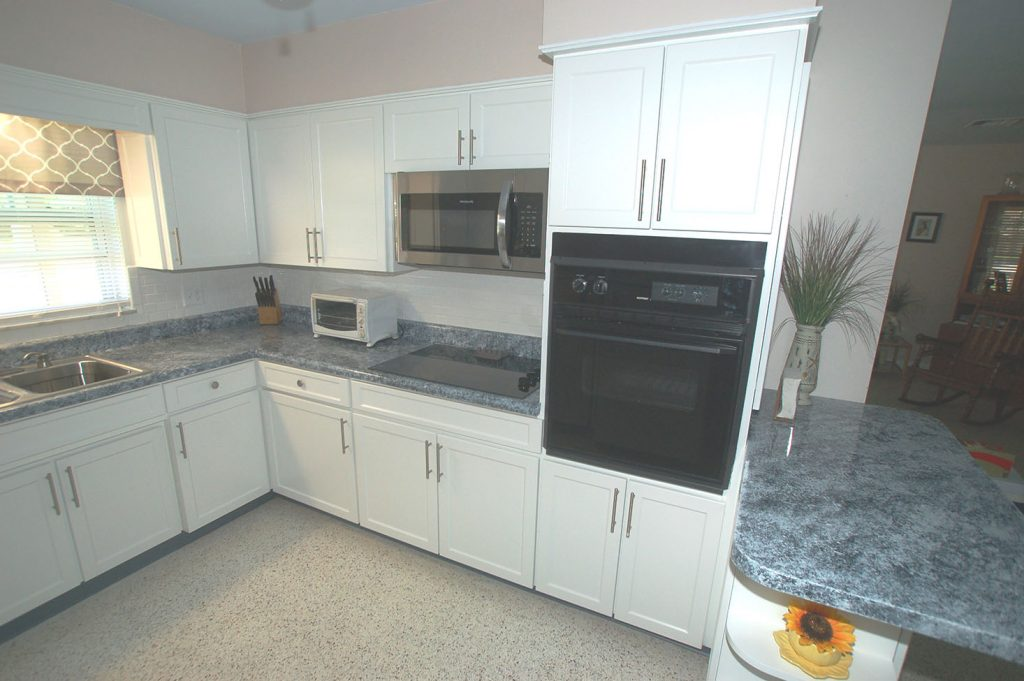 Kitchen with new white cabinets and blue granite counters