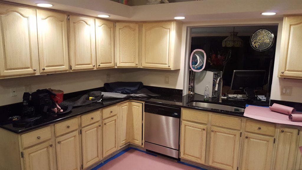Kitchen with pink floors under construction