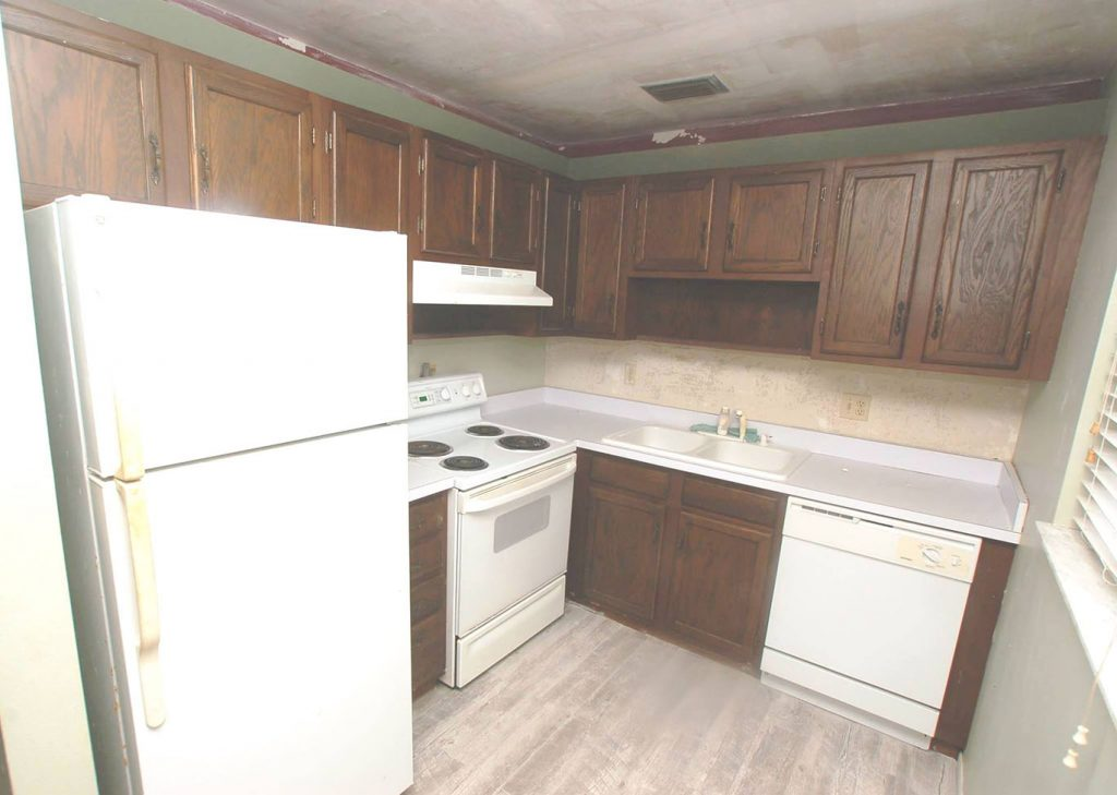 Old kitchen with dark wood grain cabinets