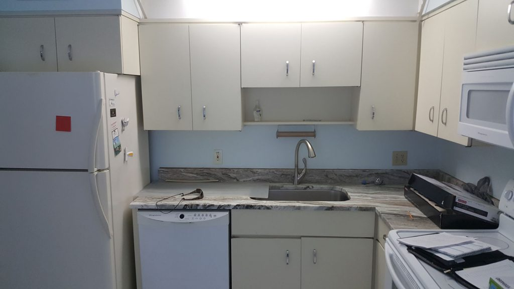 Kitchen with older cabinets