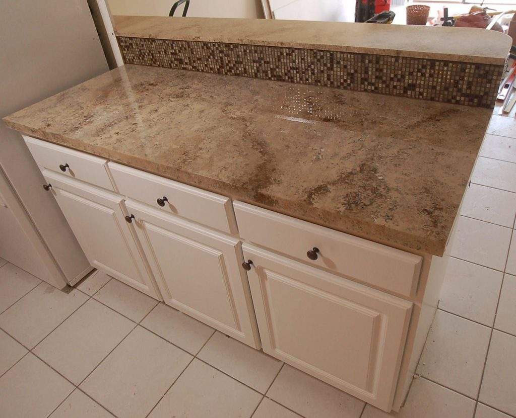 Finished cabinets and countertops in kitchen