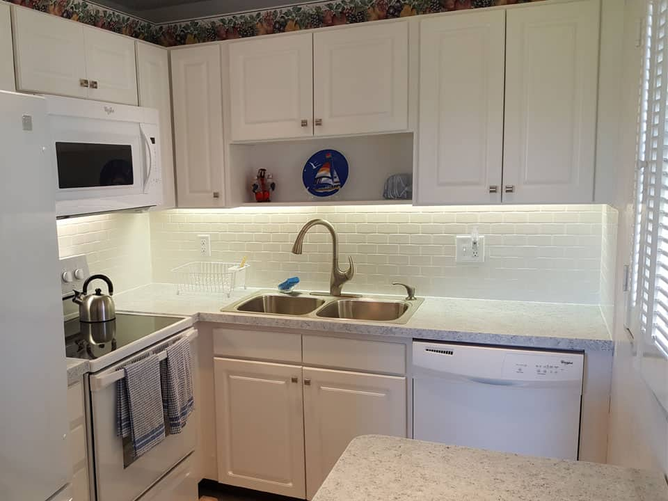 Kitchen with white cabinets after remodel