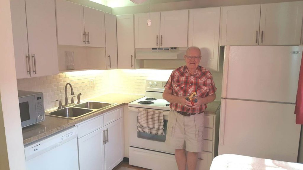 Happy customer in renovated kitchen