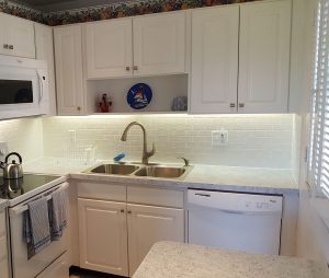 Refinished kitchen with subway tile backsplash