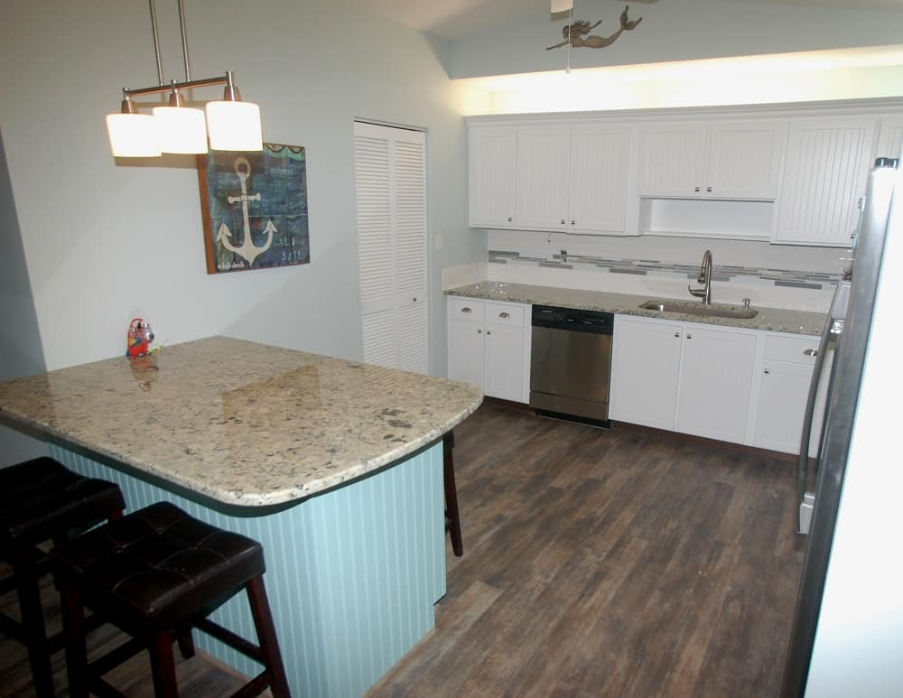 Added cabinets to kitchen after