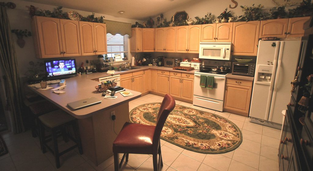 Wide shot of kitchen before refacing and resurfacing