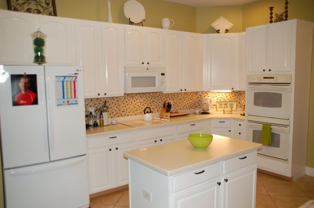 Refaced white cabinets in kitchen