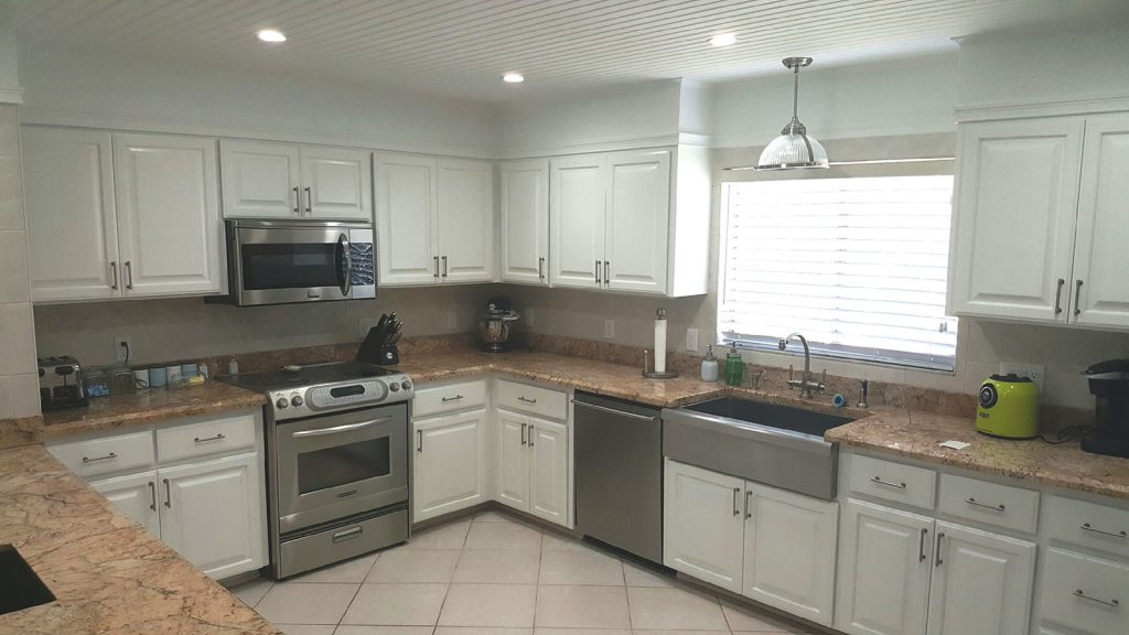 Kitchen with updated white cabinets