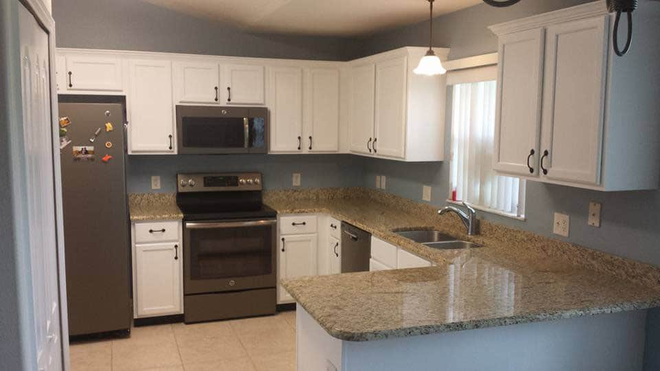 Refaced cabinets and resurfaced countertop in kitchen