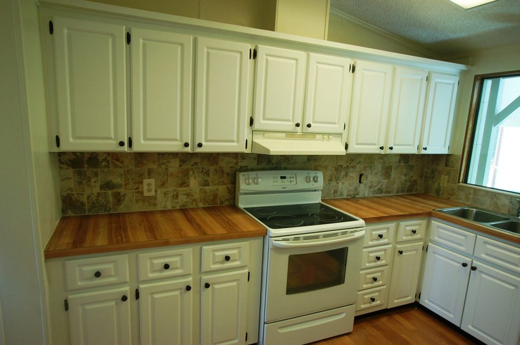 Updated kitchen with new backsplash, cabinets and countertops