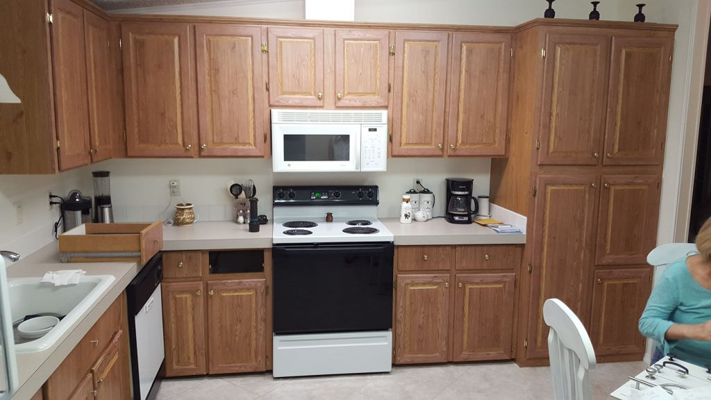 Old kitchen with wood grain cabinets