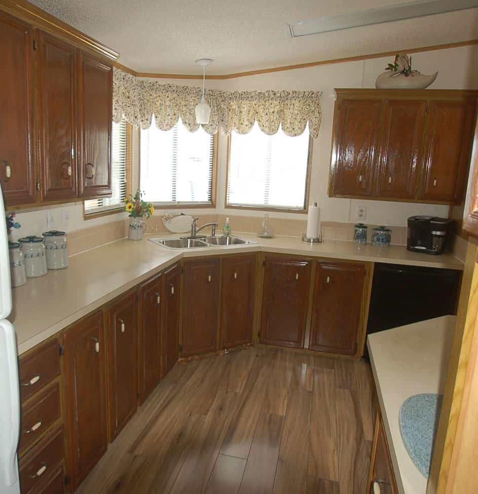 Dark wood grain cabinets in old kitchen